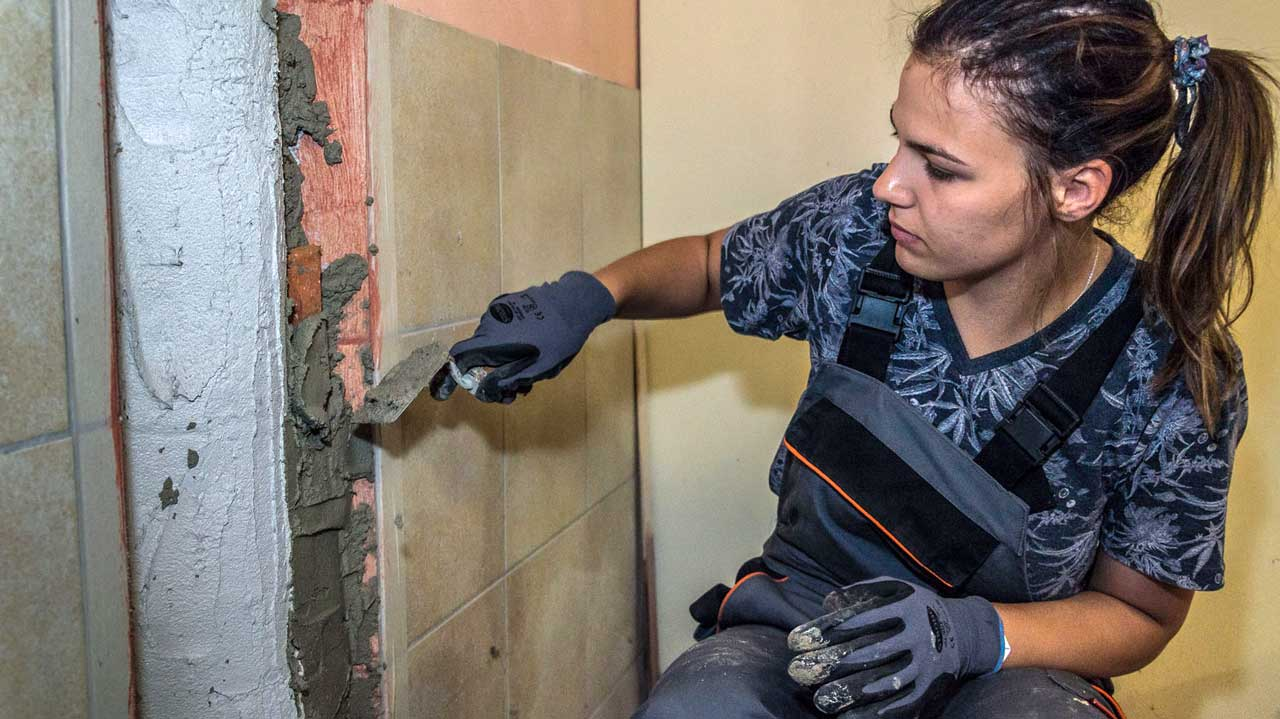 Participant with her plastering work
